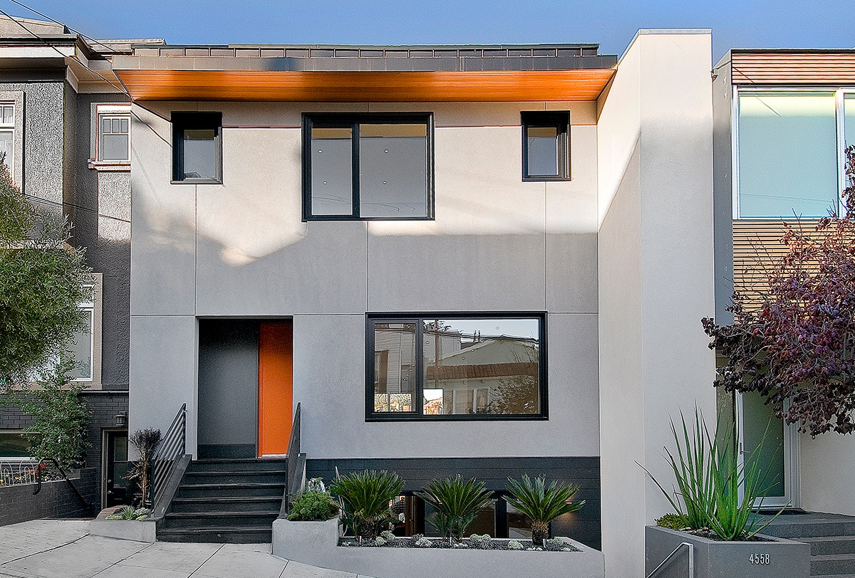 Passive House in Castro California street elevation exterior plaster hood thomas architects orange door